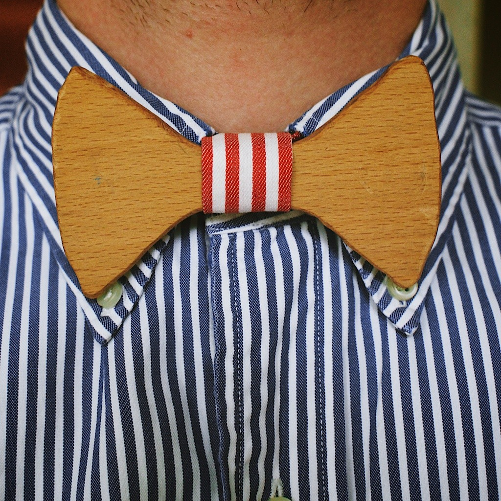 A wooden bow tie experiment paired with blue stripes